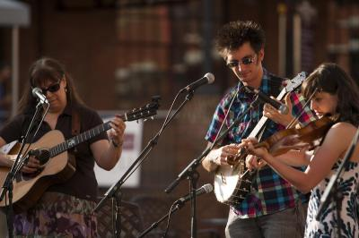 From left: Beth Williams Hartness, Adam Hurt and Stephanie Coleman perform during Back Porch Music on the Lawn Series at American Tobacco Campus.