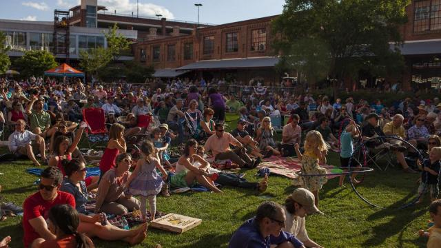 Fans packed the greenway on a mild summer day during Back Porch Music on the Lawn Series at American Tobacco Campus.