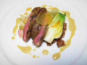 Course 1: Dr. Pepper Bulgogi Style Buck Creek Skirt Steak with Radish & Cucumber Kim Chee, Candied Ginger & Red Rice. (Photo by Judy Royal.)