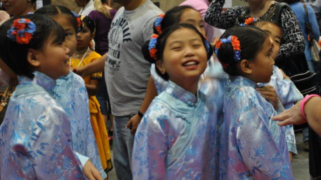 Young dancers line up for the Parade of Children at the 27th Annual International Festival of Raleigh.