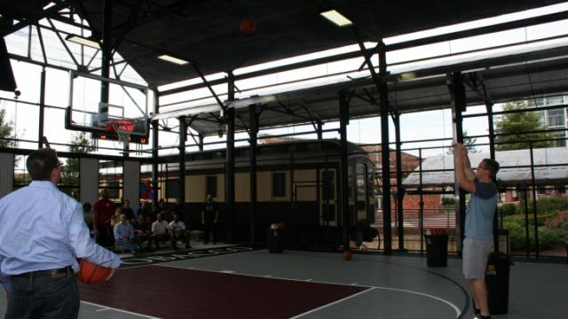 """""""The Cage,"""" an outdoor sheltered basketball court in the American Tobacco Historic District, opened with Durham YMCAs on Thursday, Oct. 4. Photo by Valerie Ward."""