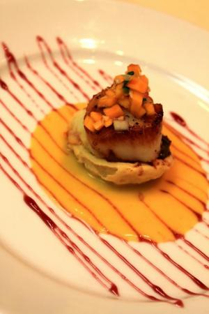 Course 1: Pan-Seared Sea Scallop over Bistro Filet with Pumpkin Shepherd's Pie, Roasted Pumpkin-Onion Cream Sauce, Red-Wine Reduction and Pumpkin Confit. (Photo from Competition Dining Facebook.)
