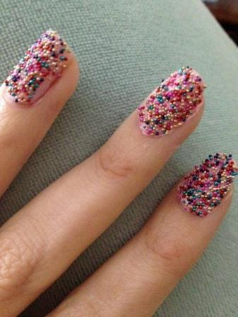 Caviar pearls go on top of this polish to create a 3D look.