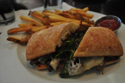 Short rib sandwich on ciabatta at Porter's Tavern.