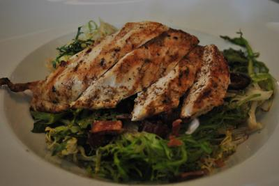 Grilled chicken on salad at Porter's Tavern.