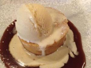 The warmed pumpkin and white chocolate bread pudding served maple-bourbon ice cream and caramel at The Oxford.