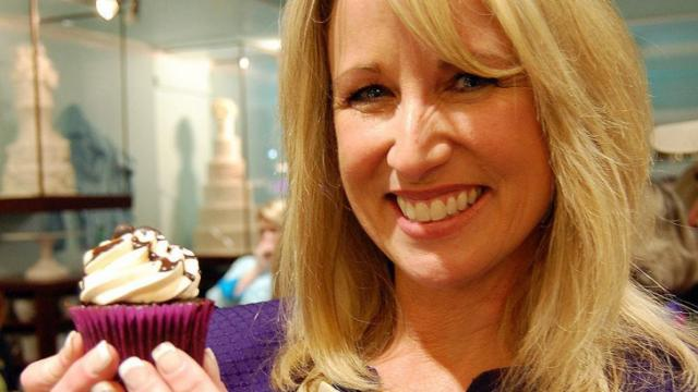 WRAL's Debra Morgan poses with her winning cupcake from Sugarland's Celebrity Cupcake Wars.