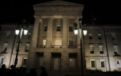 The Capitol lit up at night as tourists learned about it during the Raleigh Pub Crawl & Haunted Adventure tour Saturday night (photo by Wes Hight).
