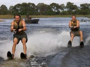 Choosing to take the Fast Forward, Hockey brothers Bates (left) and Anthony (right) must water ski in crocodile infested waters on The Amazing Race (photo from CBS.com).