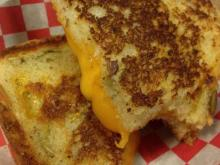 American Meltdown's De-Lish - muenster cheese served on Guglhupf's pumpkin seed Cheddar bread.