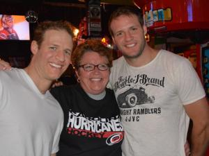 "The Battaglia brothers pose with fan at Lucky B's in Raleigh during the final episode of ""The Amazing Race"" on Sunday, May 5, 2013. Anthony and Bates Battaglia won the race and its $1 million prize."
