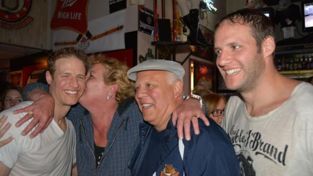 Hockey brothers Bates and Anthony Battaglia celebrate with their step-mother and father at Lucky B's after winning 'The Amazing Race.'