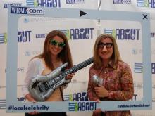 The WRAL Out & About booth had fun with props at Band Together on May 4 at Koka Booth Amphitheater.
