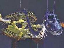Visitors operate dino sculptures at N.C. Museum of Natural Sciences