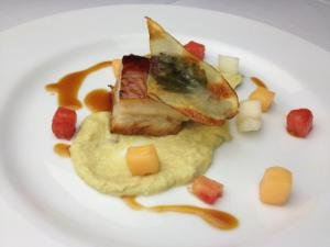 Course 1: Texas Pete® Melon Braised Pork Belly, Smoked Lemon Grass-Leek Puree, Cantaloupe Glassed Potato, Pickled Melons, Braising Jus - Chef Steve Zanini - Jimmy V's (Image from Competition Dining)