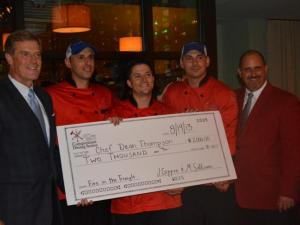 Team Flights accept their $2,000 check and red jackets after winning Fire in the Triangle.