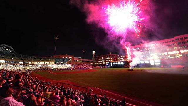 Fireworks light up the crowd of 11,536, the third largest in the park's history, following Durham's win over Norfolk Saturday, August 24, 2013 at the Durham Bulls Athletic Park in Durham, NC.