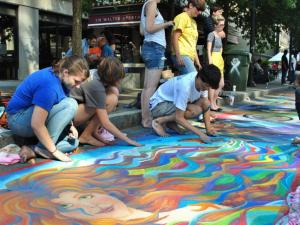 Artists create masterpieces on the streets of downtown Raleigh with chalk during SPARKcon 2013.