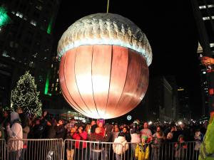 The New Year has arrived, as the big acorn falls! 2014 First Night Raleigh, N.C. Revelers gather on Fayetteville St, in anticipation of the Acorn Drop and the celebration for bringing in the new year. (Chris Baird / WRAL Contributor)