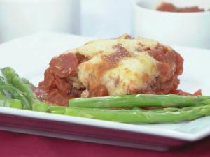 Eggplant parmesan with roasted asparagus is a heart-healthy Valentine's Day option.