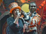 Ringling Bros. and Barnum and Bailey's Built to Amaze ringmaster Andre helps WRAL Out and About Editor Kathy Hanrahan get into character.