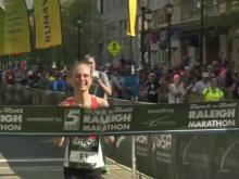 Women's winner crosses finish line at Rock 'n' Roll Marathon