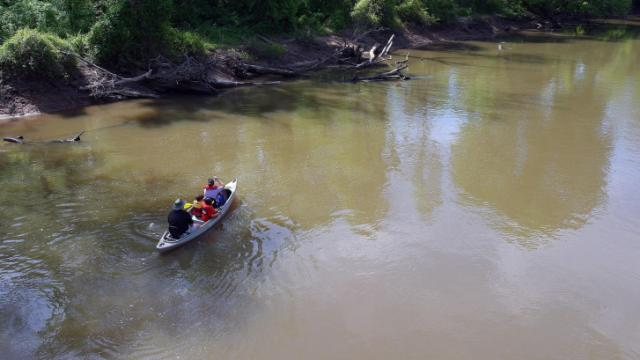 A family canoes down the Neuse River, just off the greenway in Raleigh. The Neuse flows through Falls Lake, a drinking water reservoir that has been plagued by contamination from stormwater and other sources.