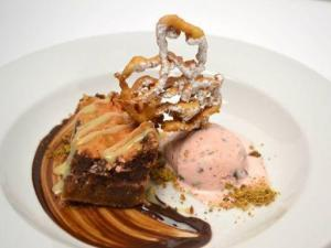 COURSE 6: Chocolate and Cheerwine Mascarpone Chess Pie, Graham Crust, Chocolate Chip Pistachio & Cheerwine Ice Cream, Funnel Cake, Dark Chocolate Ganache, Tarragon Dulce de Leche - Flights. Weighted Score: 31.926. (Image from Competition Dining)