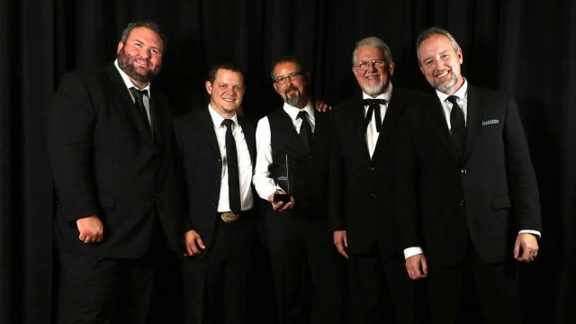Balsam Range pose with their award for Vocal Entertainer of the Year, backstage at the International Bluegrass Music Awards. (Photo by IBMA/Dave Brainard)