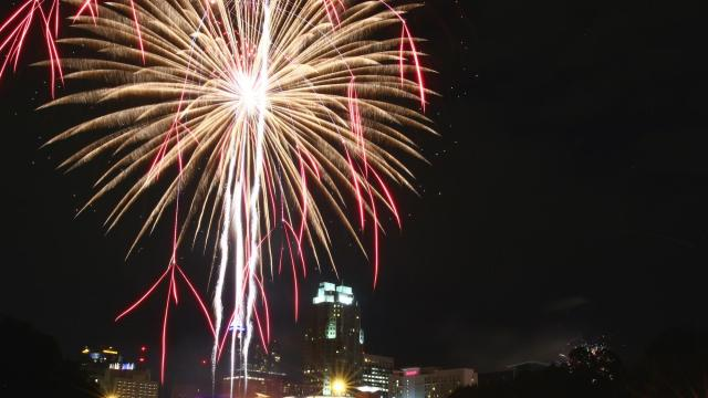 Fireworks soar over Downtown Raleigh. Raleigh held its annual Independence Day celebration on July 4, 2015. (Photo by: Jerome Carpenter/WRAL Contributor)