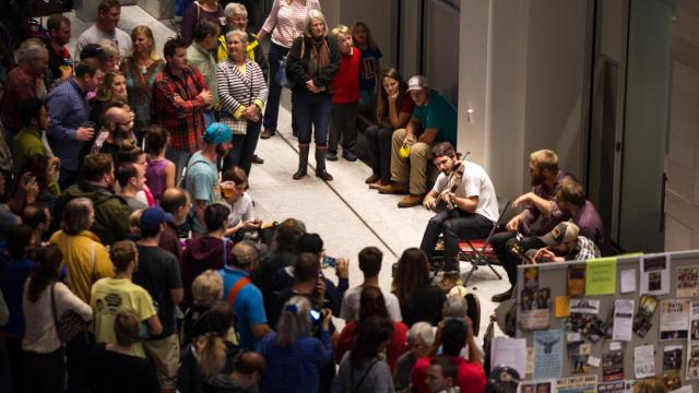 Bluegrass musicians played wherever they could find space to set up during the Wide Open Bluegrass Festival, which was being hosted indoors at the Raleigh Convention Center on Oct. 3, 2015. ( JOHN WEST/WRAL contributor)