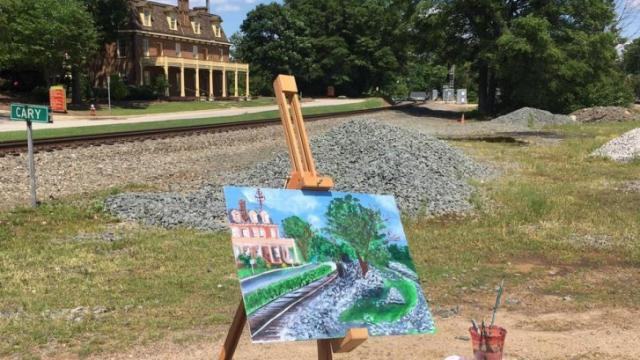 Artists attempted to paint the scenes that were right in front of them - like this acrylic painting of the Page-Walker, a historic building and muesum in downtown Cary.