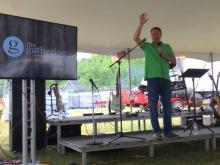 Pastor Joe from The Gathering Community Church in Fuquay-Varina delivered a short sermon under a tent at 10 a.m.