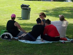 Families found a spot in the shade to enjoy live music at Destination Dix