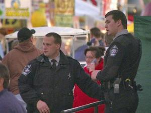 Law enforcement officers monitor the crowd at the North Carolina State Fair.