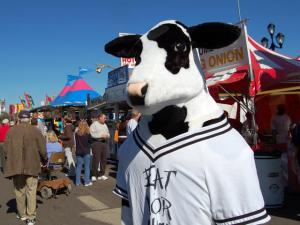 "The Chick-Fil-A cow met with fans and helped encourage people to ""Eat More Chicken"" outside of the South Raleigh Civitan Club stand at the State Fair on Oct. 20, 2009."