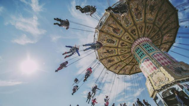 Children and adults take a ride in the sky on the last day of the 2013 NC State Fair.