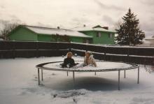 Arianne Brown sits on her childhood trampoline with her older sister, Megan. (Deseret Photo)