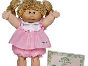 This 2005 image provided by 4Kids shows a Cabbage Patch Kid from 1983. Some favorite toys from the 1980s have gotten 21st century updates as children who grew up playing with the iconic toys are having babies of their own. (AP Photo/4Kids)