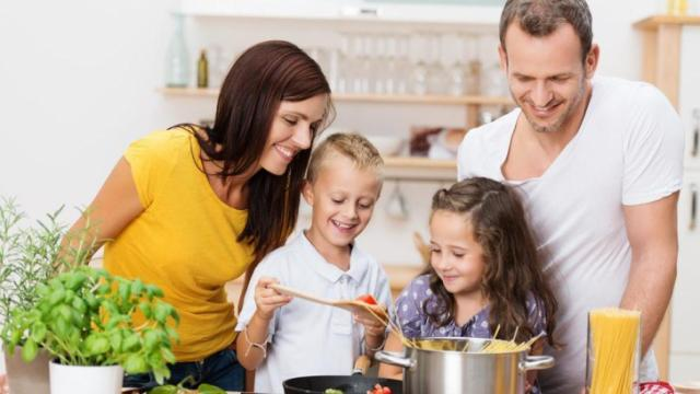 According to the CDC, Americans' waistlines continue to grow. By having kids help cook meals, parents encourage healthy eating habits and combat obesity now and in children's future. Here are a few ways kids can help in the kitchen. (Deseret Photo)