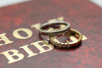Two diamond wedding bands for a double-bride wedding on the cover of the bible (Deseret Photo)