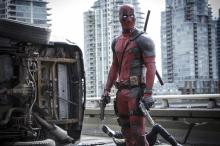 """This image released by Twentieth Century Fox shows Ryan Reynolds in a scene from the film """"Deadpool."""" (Deseret Photo)"""