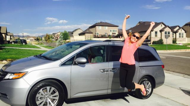 Erin Stewart has joined the ranks of minivan drivers and says she is pretty proud of the precious cargo inside. (Deseret Photo)
