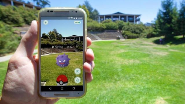 "APTOS, CALIFORNIA - JULY 11, 2016: The hit augmented reality smartphone app ""Pokemon GO"" shows a Pokemon encounter overlain on a college campus in the real world. (Deseret Photo)"
