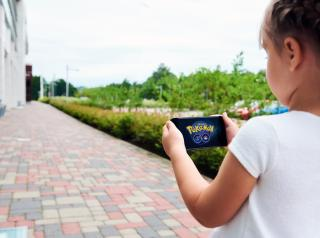Riga, Latvia- July 17, 2016 : Little girl playing a Pokemon Go game outdoors. Pokemon Go is a popular virtual reality game for mobile devices. The game allows players to capture, battle, and train virtual creatures, called Pokemon, who appear on device screens as though in the real world. (Deseret Photo)