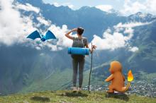 girl in the mountains exploring the world together with augmented reality game of Pokemon Go (Deseret Photo)