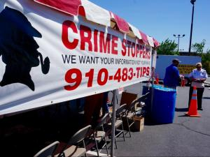 Customers lined up to take a plate at the annual Crime Stoppers barbecue in Fayetteville.
