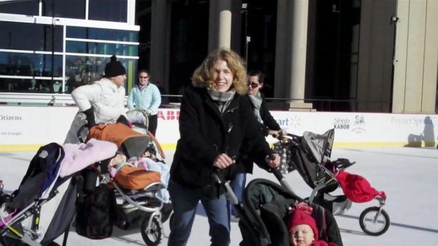 Sarah Lindenfeld Hall skating during stroller skating at downton Raleigh's Winterfest.