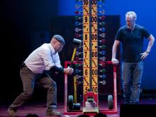 Jamie Hyneman tests his strength with Adam Savage looking on.