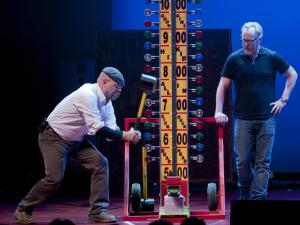 Jamie Hyneman tests his strength with Adam Savage looking on. Photo Credit: © 2012 DavidAllenStudio.com